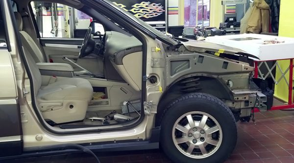 Missing door on SUV in bob's auto body